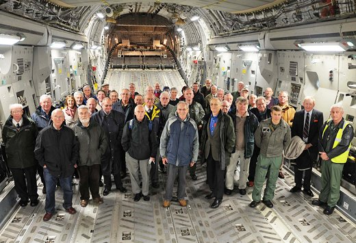 A cheerful crowd of SOFFAAM members on a day out at RAF Brize Norton, all assembled inside the enormous fuselage of the C17 heavy lift aircraft.