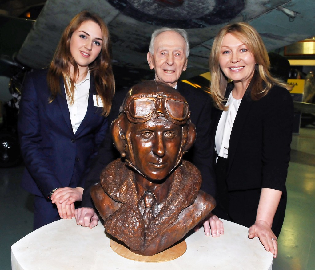 """BBC radio celebrity Kirsty Young stands to Captain Brown's left after the unveiling and the talented young sculptor, Jenna Gearing, to his right."""